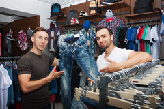 Guys in a clothing store Royalty Free Stock Image