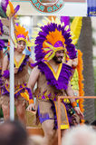 Guys in colored feathers at Gay pride parade Royalty Free Stock Images