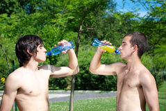 Guys drinking water Stock Image