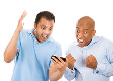 Guys excited by what they see on their smart phone Stock Photos