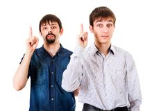 Guys with Finger Up. Two Guys with Fingers Up on the White Background royalty free stock image
