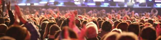 Guys and girls of the audience during live concert. Many guys and girls of the audience during live concert from the pop star outdoors royalty free stock photography
