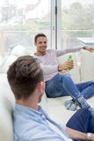 Guys Hanging Out At Home Royalty Free Stock Photography