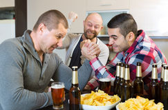 Guys having arm wrestling competition Royalty Free Stock Image
