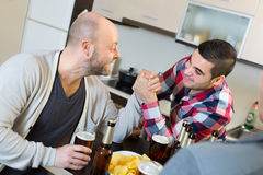 Guys having arm wrestling competition Stock Photography