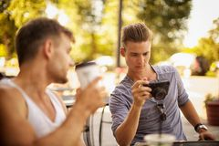 Guys having coffee Royalty Free Stock Photos