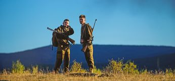 Guys hunting nature environment. Hunting season. Masculine hobby activity. Men bearded hunters with rifle nature. Background. Experience and practice lends royalty free stock photo