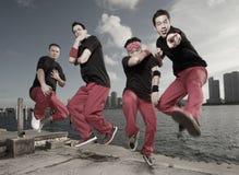 Guys jumping. Group of guys jumping in midair stock photos