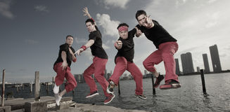 Guys jumping royalty free stock photo