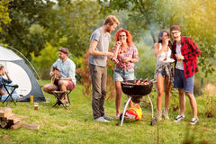 Guys and lassies feed each other with skewers Royalty Free Stock Photography