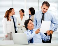 Guys at the office Stock Image