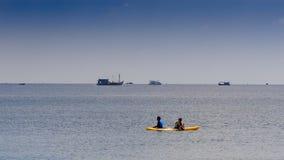 Guys Paddle Kayak along Azure Sea against Skyline stock video