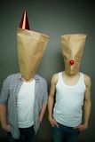 Guys in paper bags Stock Photos