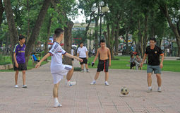 Guys are playing a ball in park of Hanoi, Vietnam Stock Images
