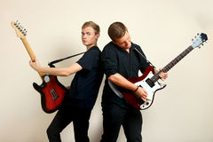 Guys playing electric guitars Royalty Free Stock Images