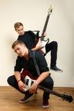 Guys playing electric guitars Stock Image