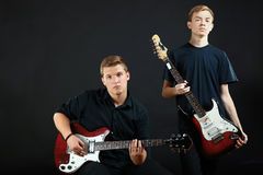 Guys playing electric guitars Stock Images