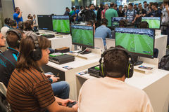 Guys playing at Games Week 2014 in Milan, Italy Stock Images