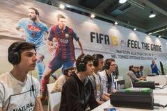 Guys playing at Games Week 2014 in Milan, Italy Royalty Free Stock Photos