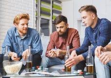 Men playing poker game together at home raising bet stock photos