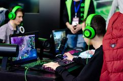 Kyiv, Ukraine - April 12, 2019: The guys are playing a video game royalty free stock photo