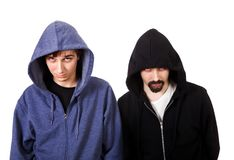 Guys Portrait Isolated. Two Sullen Guys Isolated on the White Background stock photo