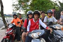 Guys posing on motorbikes Royalty Free Stock Images