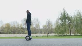 Guys ride on a Segway stock footage