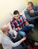 Guys sharing problems at the table Royalty Free Stock Images
