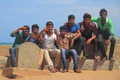Guys are sitting outdoor and enjoying fresh wind in Kanyakumari, India Stock Images