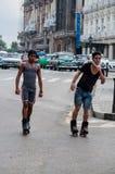 Guys skate in Havana, Cuba Stock Photo