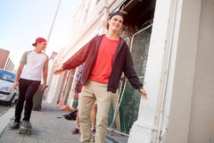 Guys skateboarders in street Stock Images