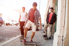 Guys skateboarders in street Stock Image