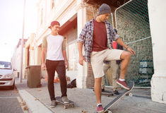 Guys skateboarders in street Stock Photos