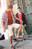 Guys skateboarders in street Royalty Free Stock Photos