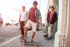 Guys skateboarders in street Stock Image