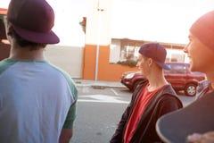 Guys skateboarders in street Stock Photos