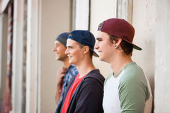 Guys skateboarders in street Royalty Free Stock Photos