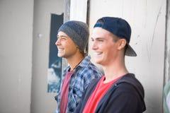 Guys skateboarders in street Stock Images