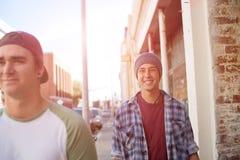 Guys skateboarders in street Royalty Free Stock Photo