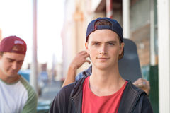 Guys skateboarders in street Royalty Free Stock Images