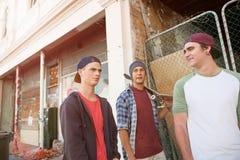 Guys skateboarders in street Stock Photography