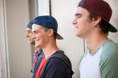 Guys skateboarders in street Royalty Free Stock Image