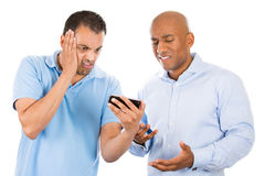 Guys upset at what they see on their smart phone Stock Photo