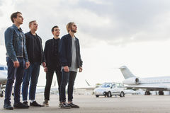 Guys waiting for airplane arrival Royalty Free Stock Photography