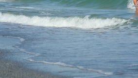 Guys walking on water, foam waves. Two guys walking on water on foam waves on the beach, Black Sea stock video