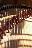 Guzheng. Or gu zheng,  also simply called zheng  is a Chinese plucked zither. It has 18-23 or more strings and movable bridges Royalty Free Stock Photo