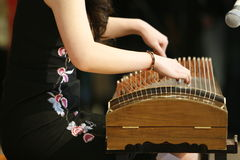 Guzheng Chinese Musical Instrument. An image of a lady playing the Guzheng, a traditional chinese musical instrument Royalty Free Stock Image
