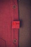 Guziki i czerwony prezent. Obrazy Royalty Free