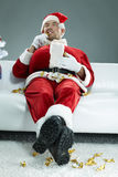 Guzzling Santa. Portrait of obese Santa chewing sweets Stock Photography